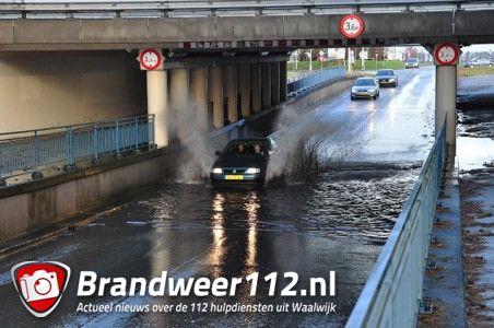Veel water onder viaduct aan de Hertog Janstraat Waalwijk