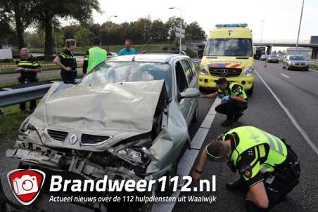 Auto botst op vrachtwagen op A59, bestuurder gewond