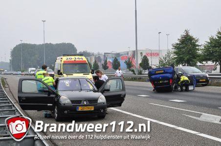 Auto op zijn kop na aanrijding op de A59 (Maasroute) Waalwijk